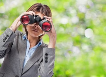 woman-looking-through-binoculars_1187-1049